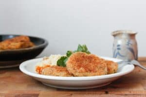 potato patties on a white plate.
