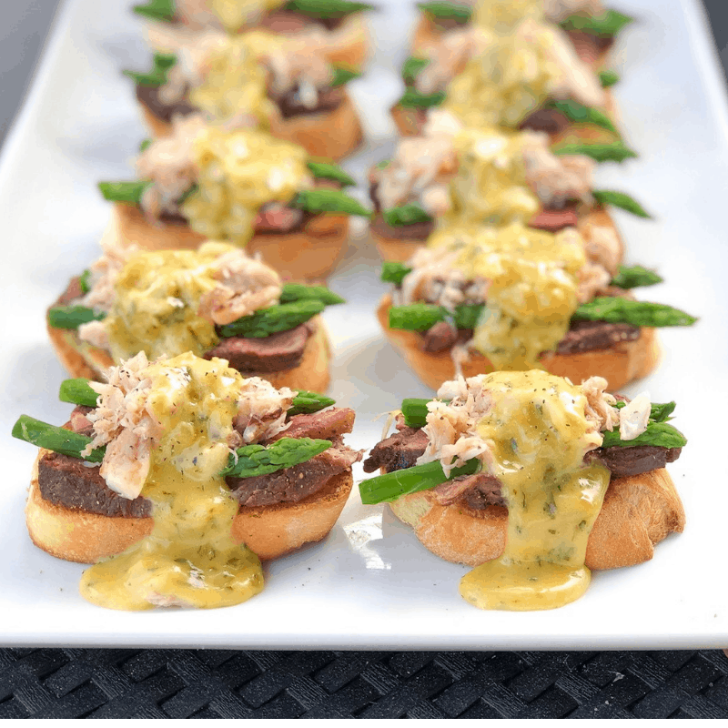 fancy steak hors d'oeuvres with asparagus and crab.