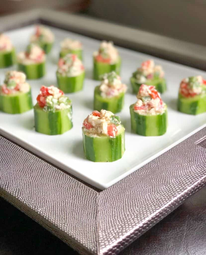 cucumber canapes on a white plate