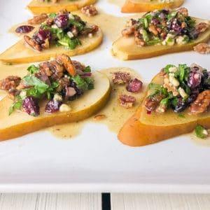 pear gorgonzola bruschetta on white plate