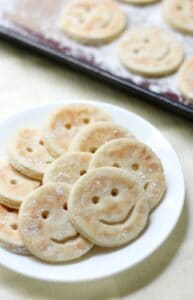 smiley face potatoes on a plate.