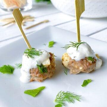 Greek lamb meatballs appetizer with feta cheese.