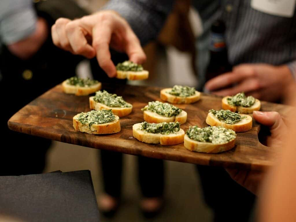 crostini being passed around on cutting board