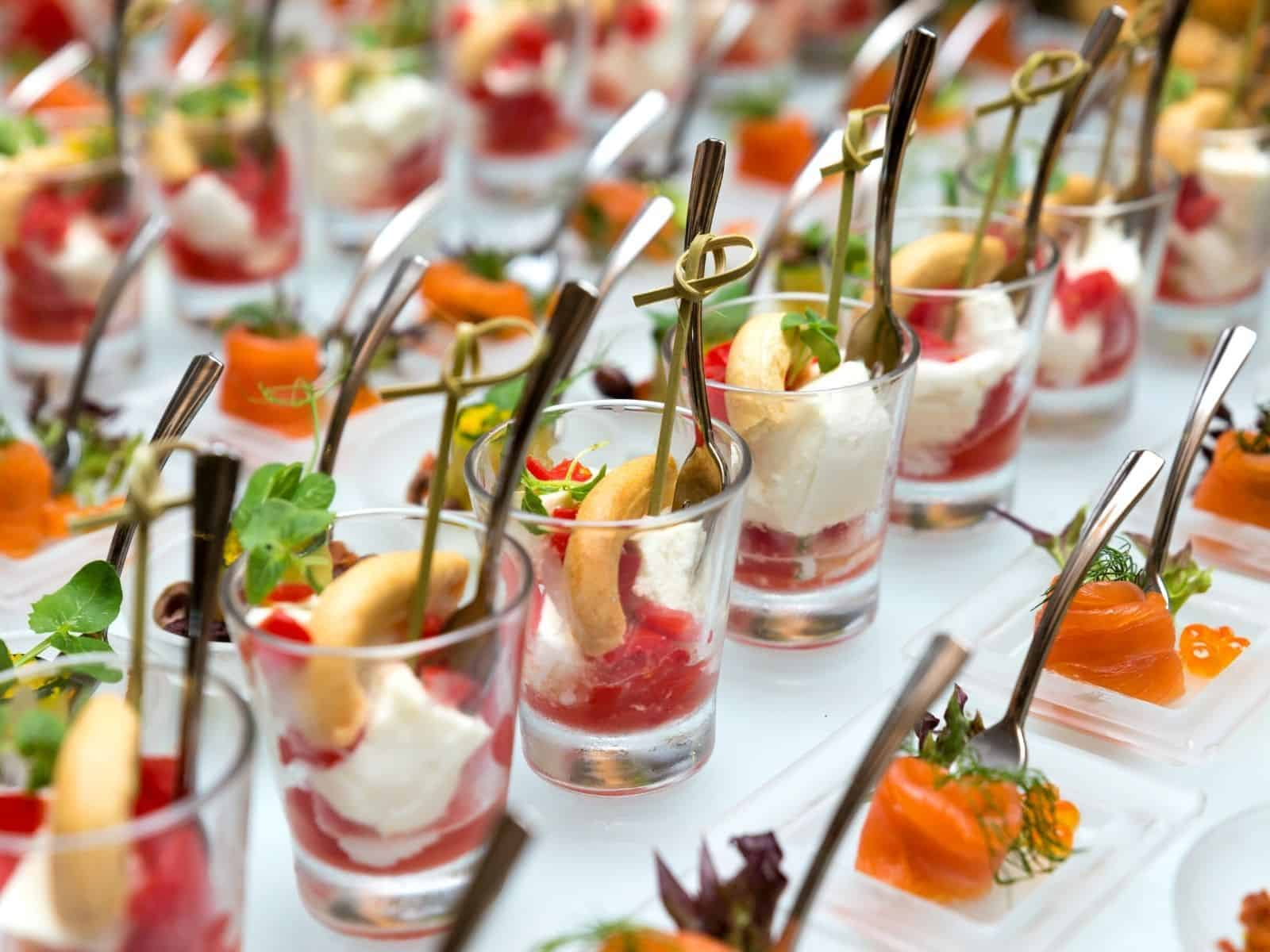 appetizer shooters on plate with mini forks.