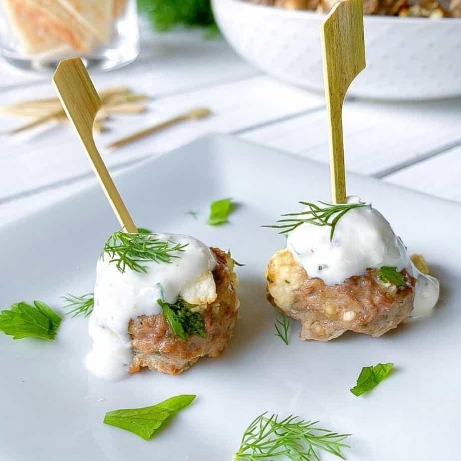 lamb meatballs with feta cheese on skewers