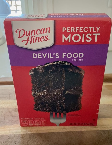 box of duncan hines moist devil's food cake mix on counter