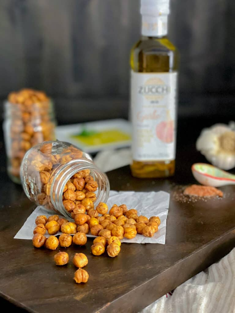 roasted chickpeas poured out onto a cutting board with spices