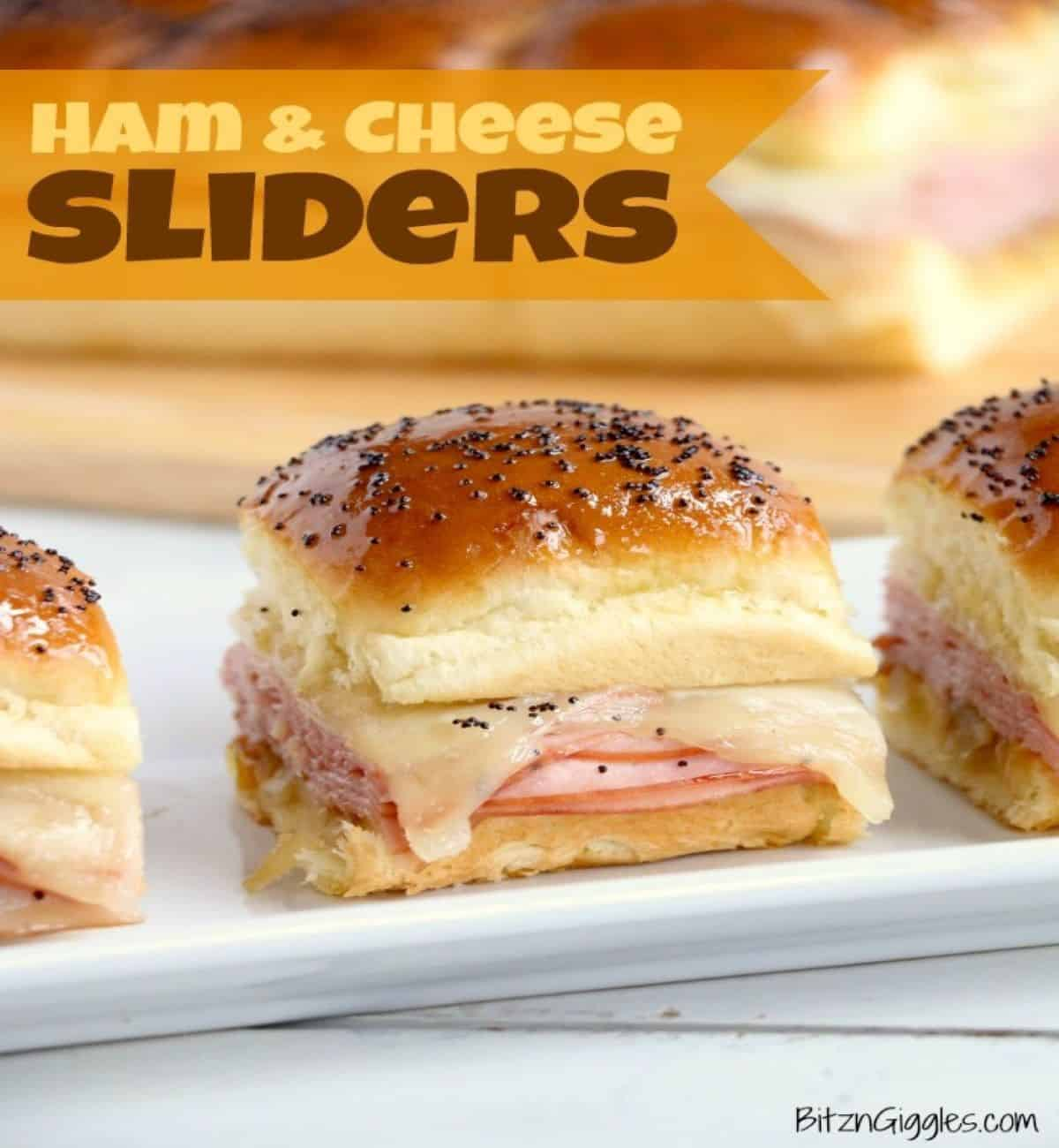 ham and cheese slider sandwiches on a plate.