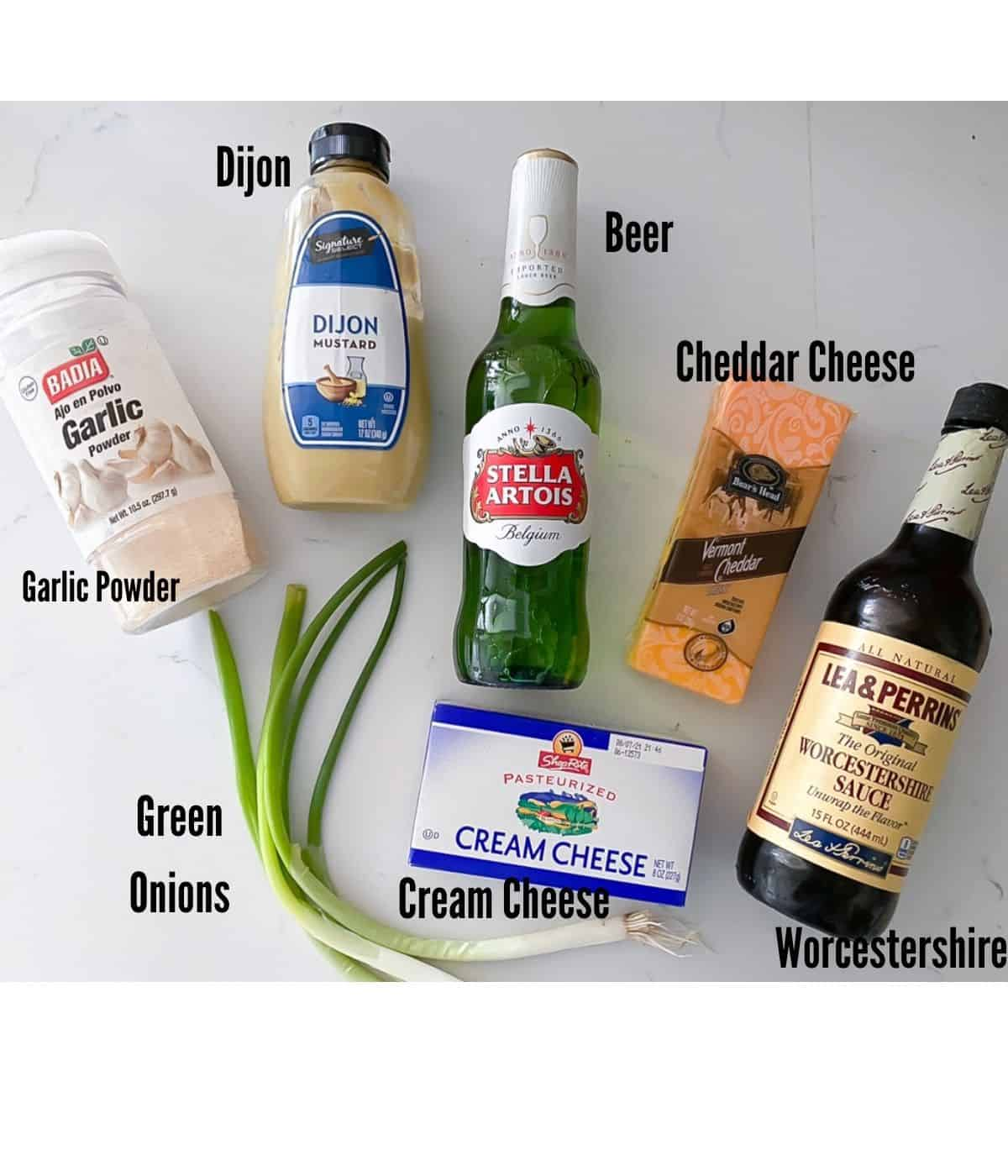 Ingredients laid on table to make cheesy beer dip.