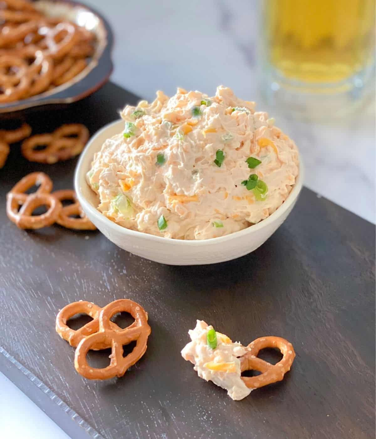 Cheddar cheese beer dip for pretzels served cold in a bowl.