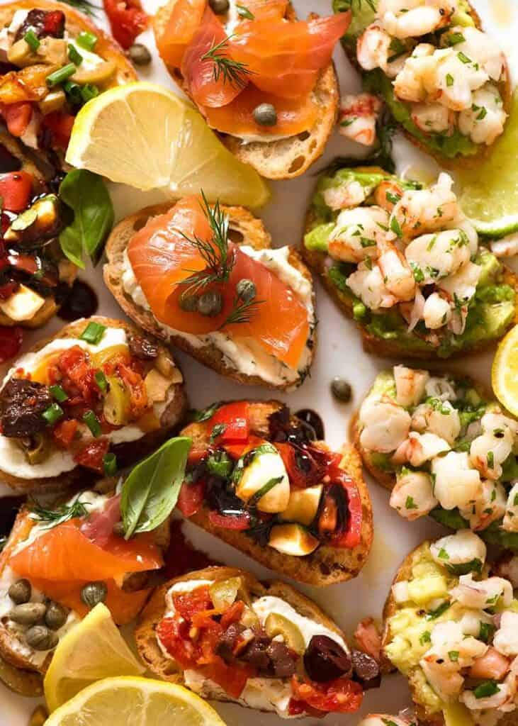 holiday crostini with salmon shrimp capers.