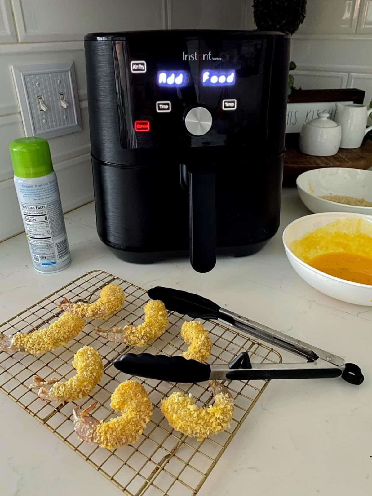 Crispy panko buffalo shrimp ready to go in the air fryer.