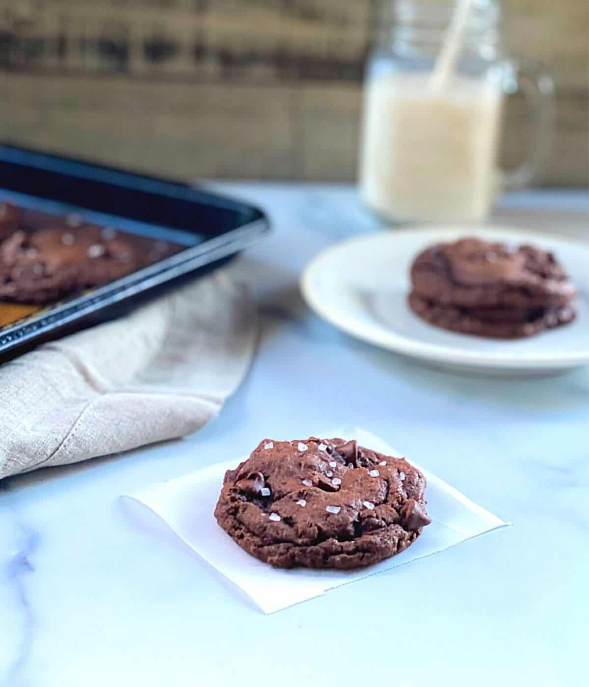 chocolate chip cake batter cookies on wax paper square with sea salt.