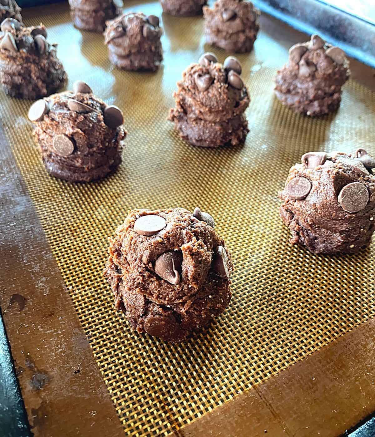 raw chocolate chip cake mix cookie balls on baking sheet.