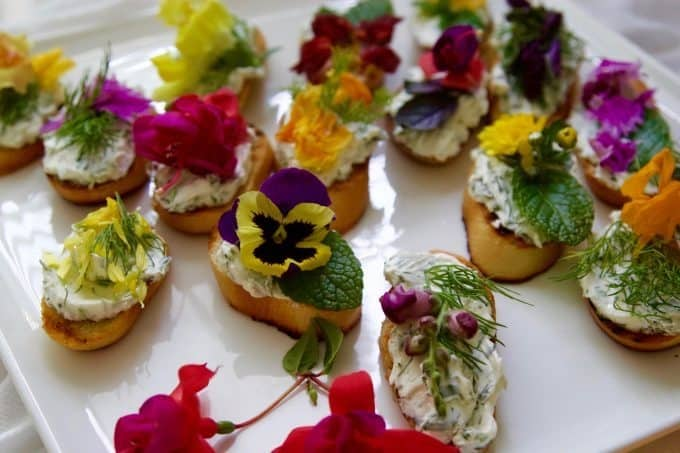 crostini with edible flowers and herbs.