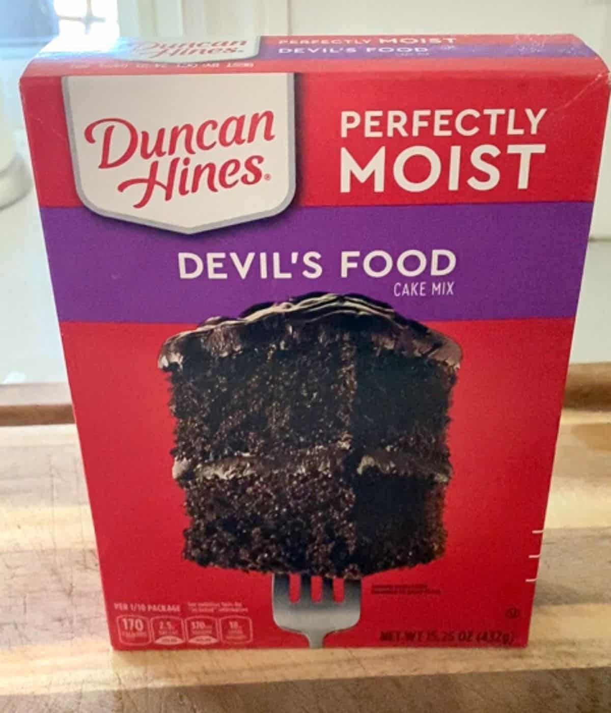 box of duncan hines moist devil's food chocolate cake mix on counter.