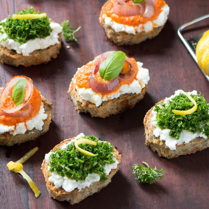 ricotta crostini on board with parsley.