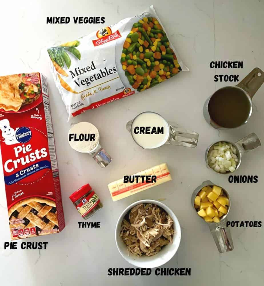 Ingredients used to make chicken pot pie on a table.