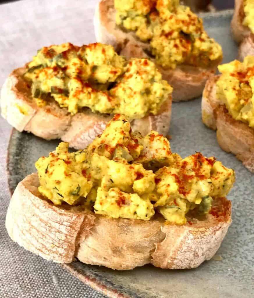 vegan deviled egg crostini on plate.