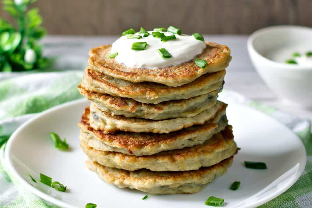 Boxty Irish potato pancakes with green onions and sour cream.