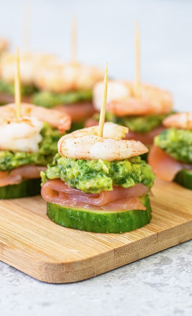 shrimp and green guacamole skewers on cucumbers.