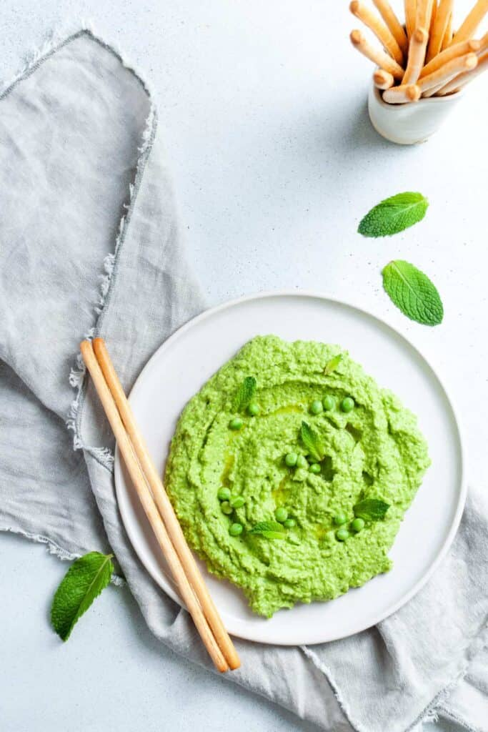 pea and mint dip on a white plate.