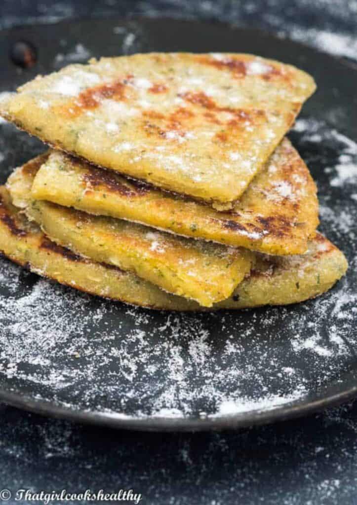 Irish potato pancakes stacked on a plate.