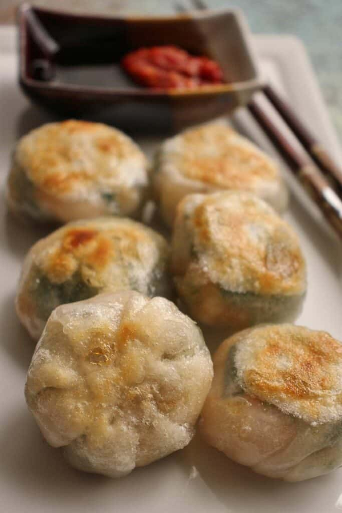 Chinese dumplings on a tray.