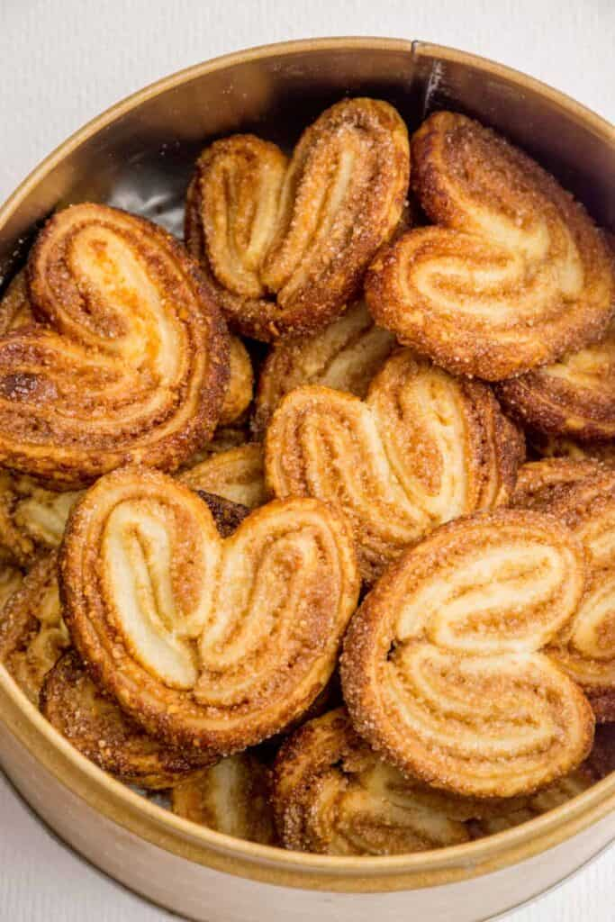 A tin full of cinnamon palmiers.