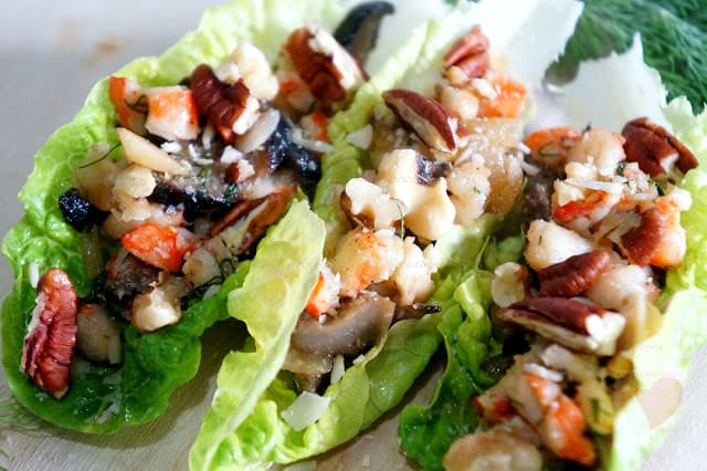 lettuce boats filled with shrimp and nut mixture.