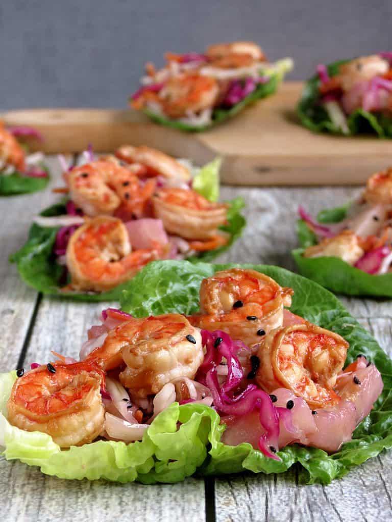 Lettuce wraps filled with shrimp and vegetables.