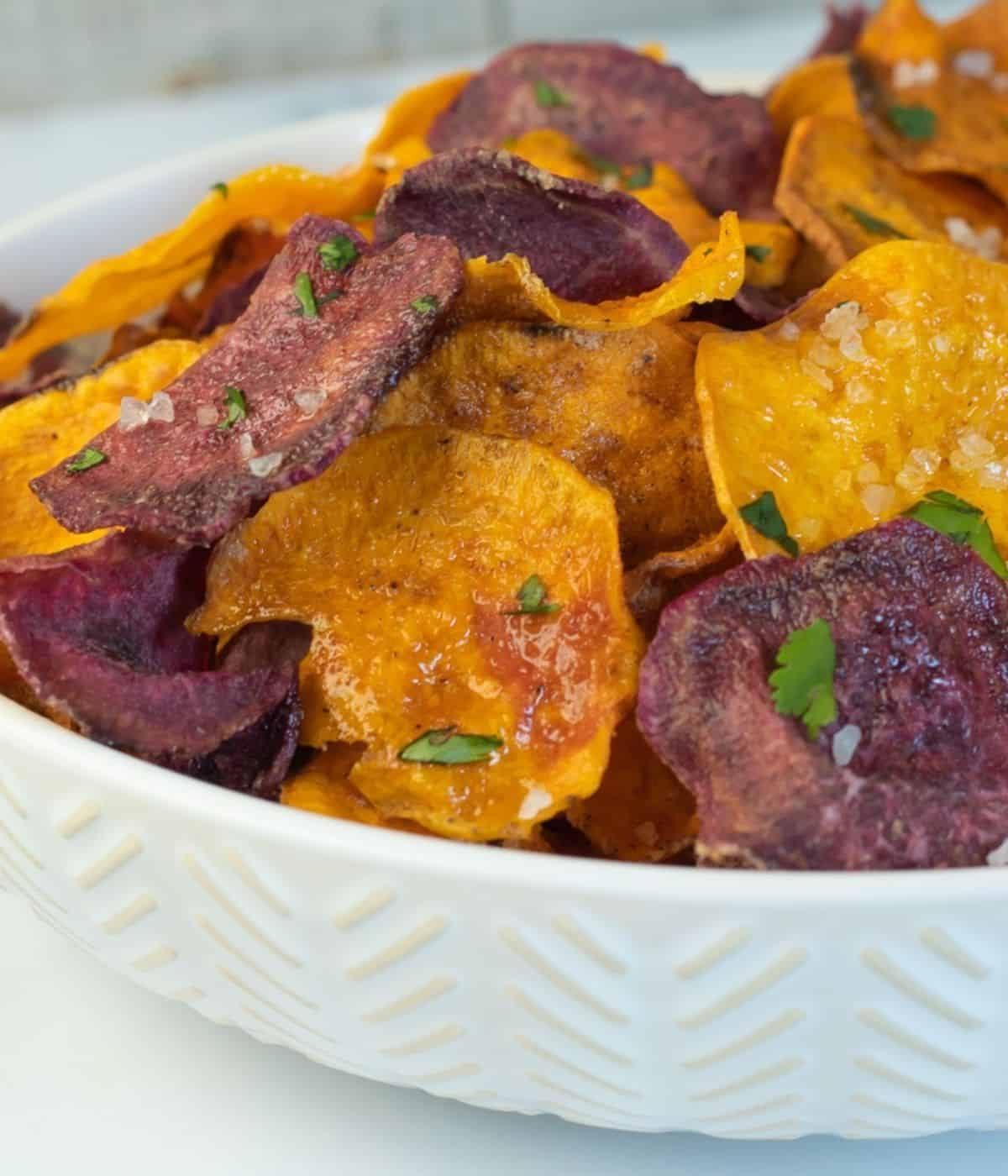 Air fryer sweet potato chips with sea salt in a bowl.