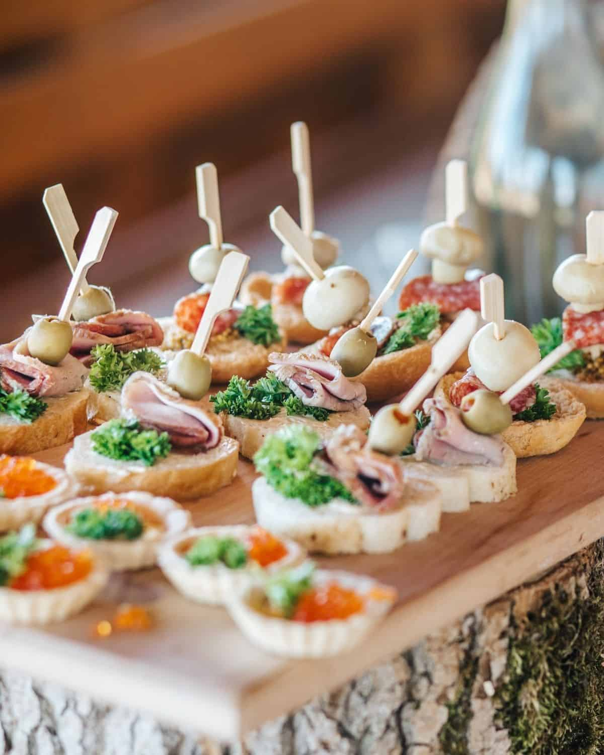 appetizers at a cocktail party on cutting board.