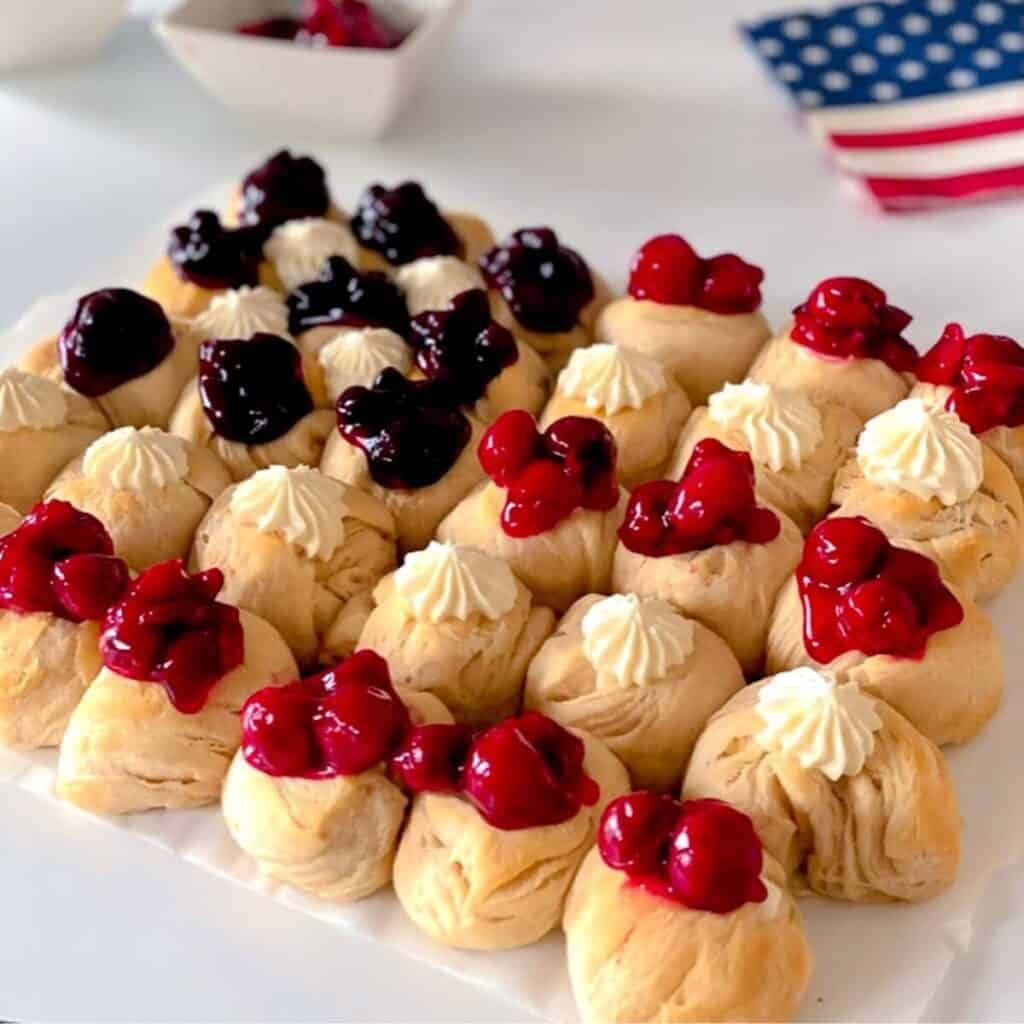 red, white and blue american flag dessert on table.