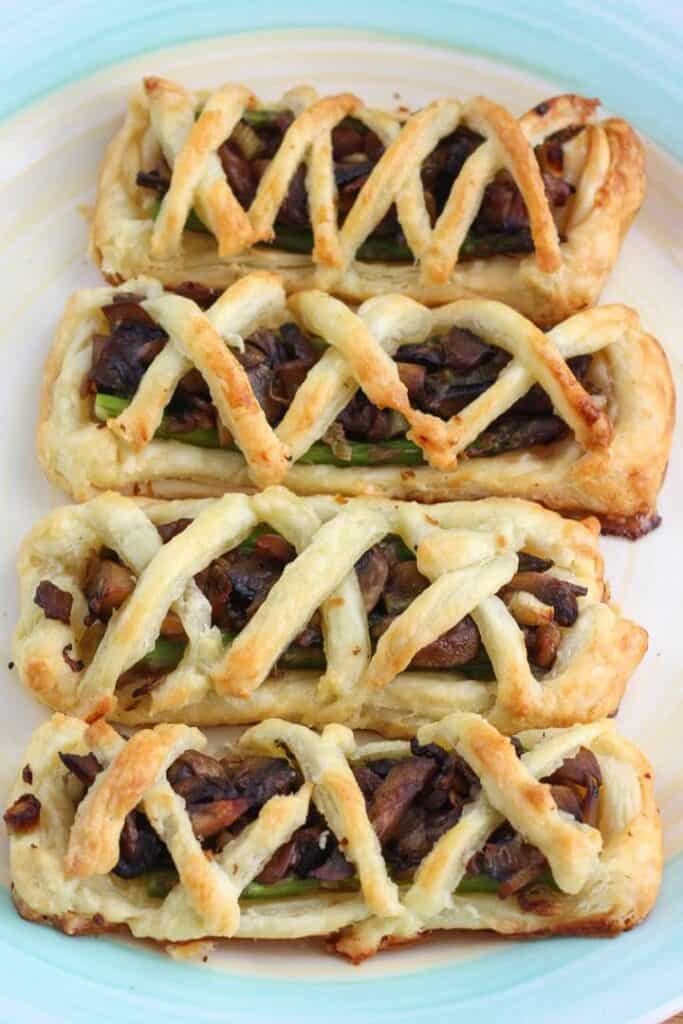 A row of mushroom and asparagus pastires.