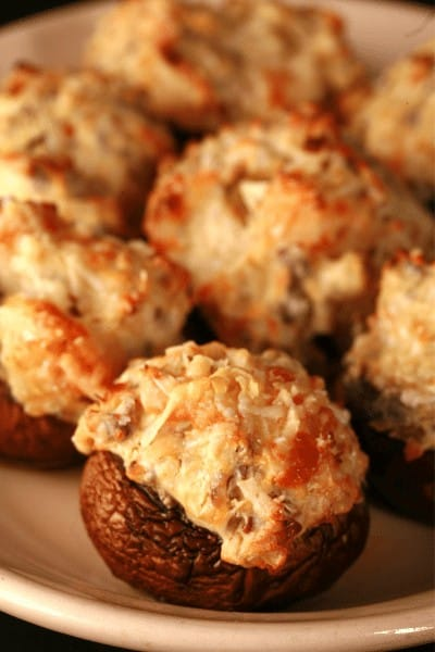 Cooked stuffed mushrooms on a plate.
