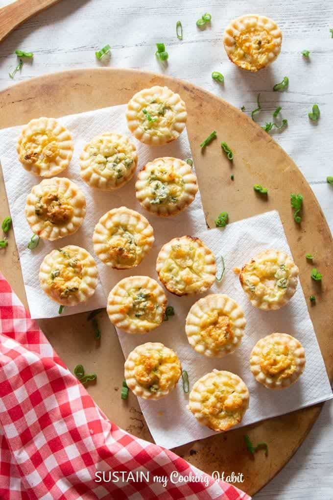 Shrimp puff pastries on white napkins.