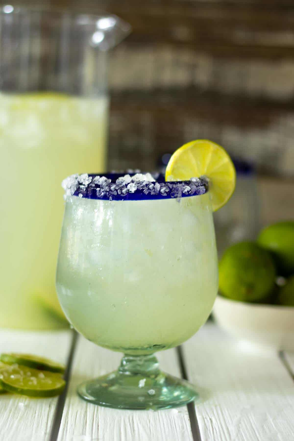 Margarita recipe on table with salt and lime.