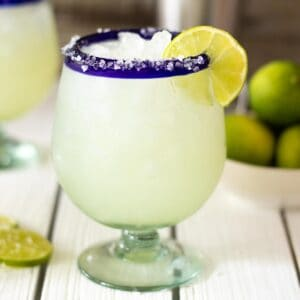 Classic margarita on table without sugar and lime garnish.