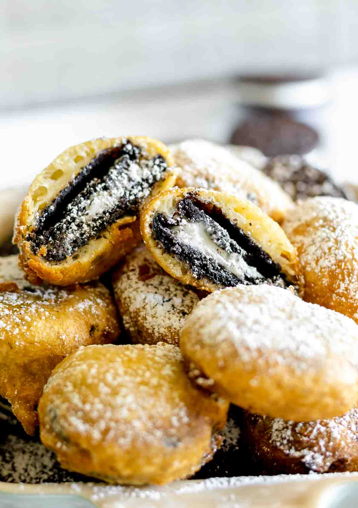 The inside of a deep fried Oreo cookie dusted with powdered sugar.