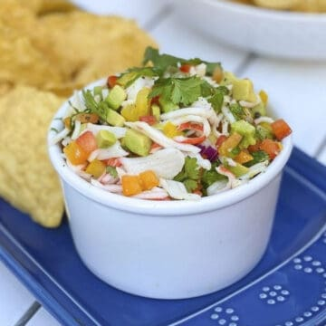 Crab ceviche in a bowl with tortilla chips.