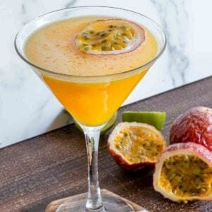 Passion fruit vodka martini on a table.