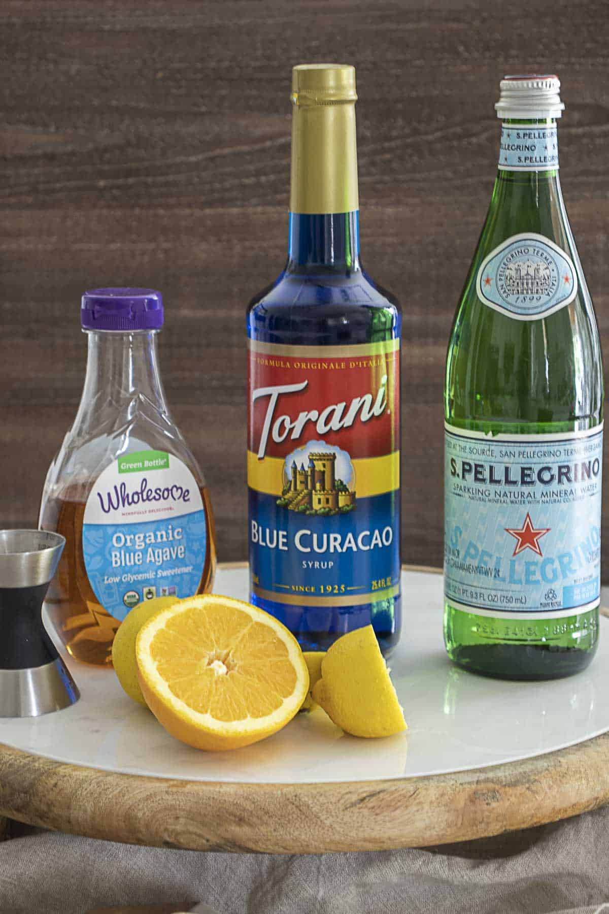 Ingredients to make a blue lagoon mocktail on table.