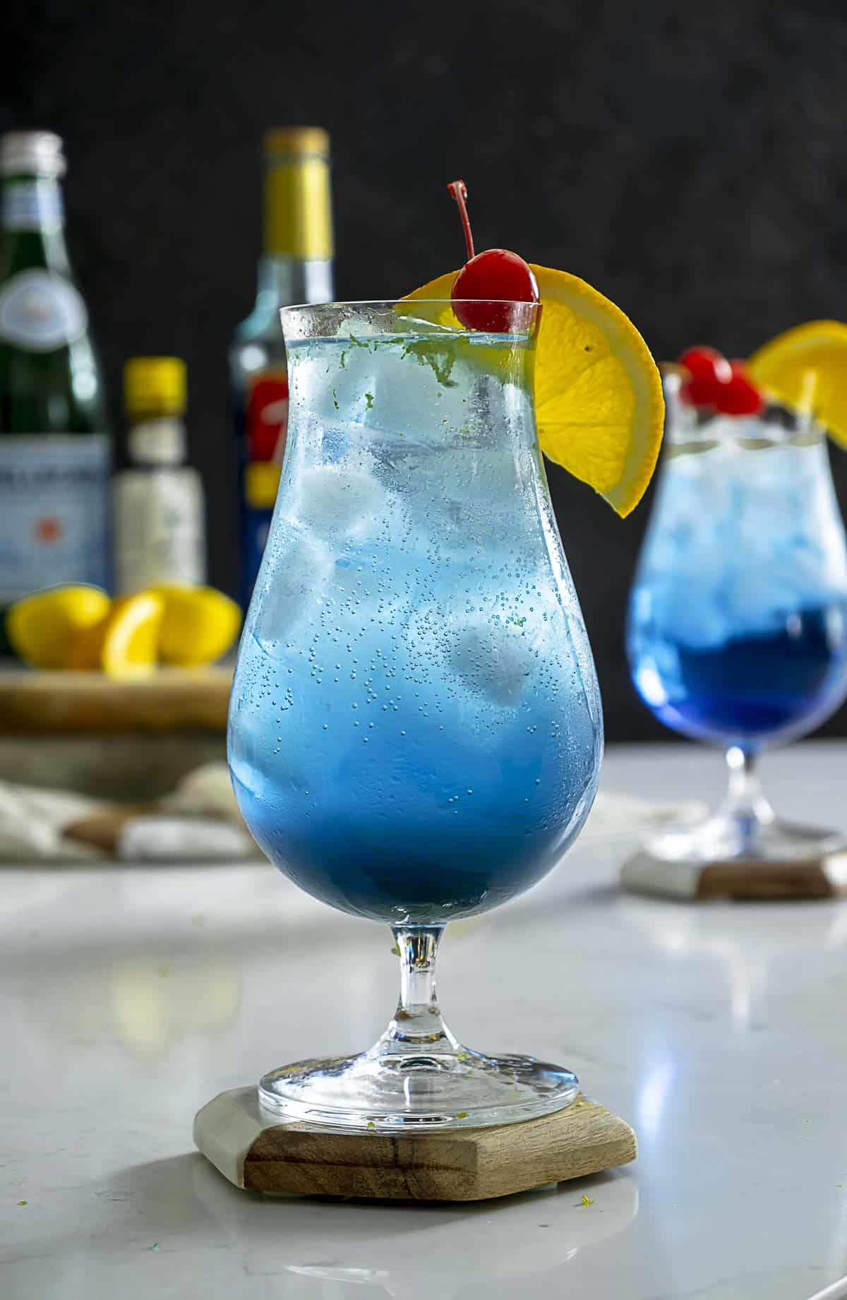 Blue lagoon drink without alcohol on table.