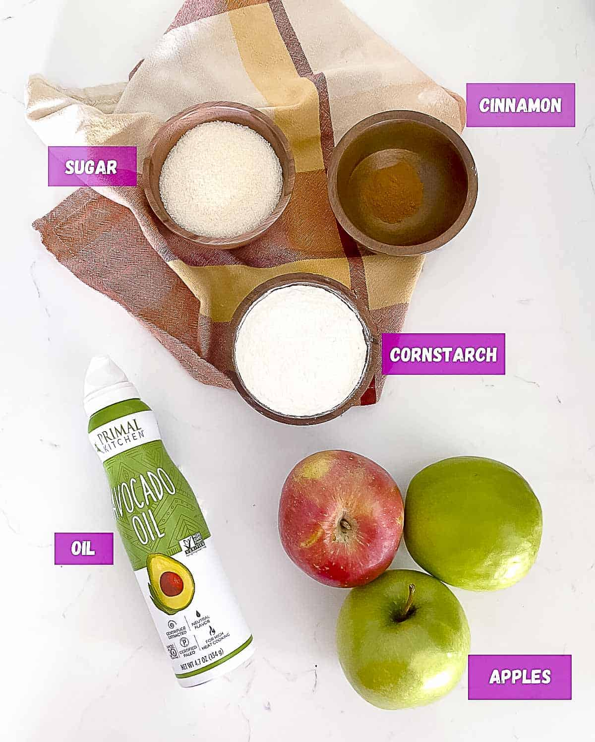 Ingredients to make fried apples on a table.