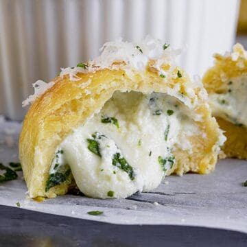 Mini calzone bites appetizer stuffed with cheese.