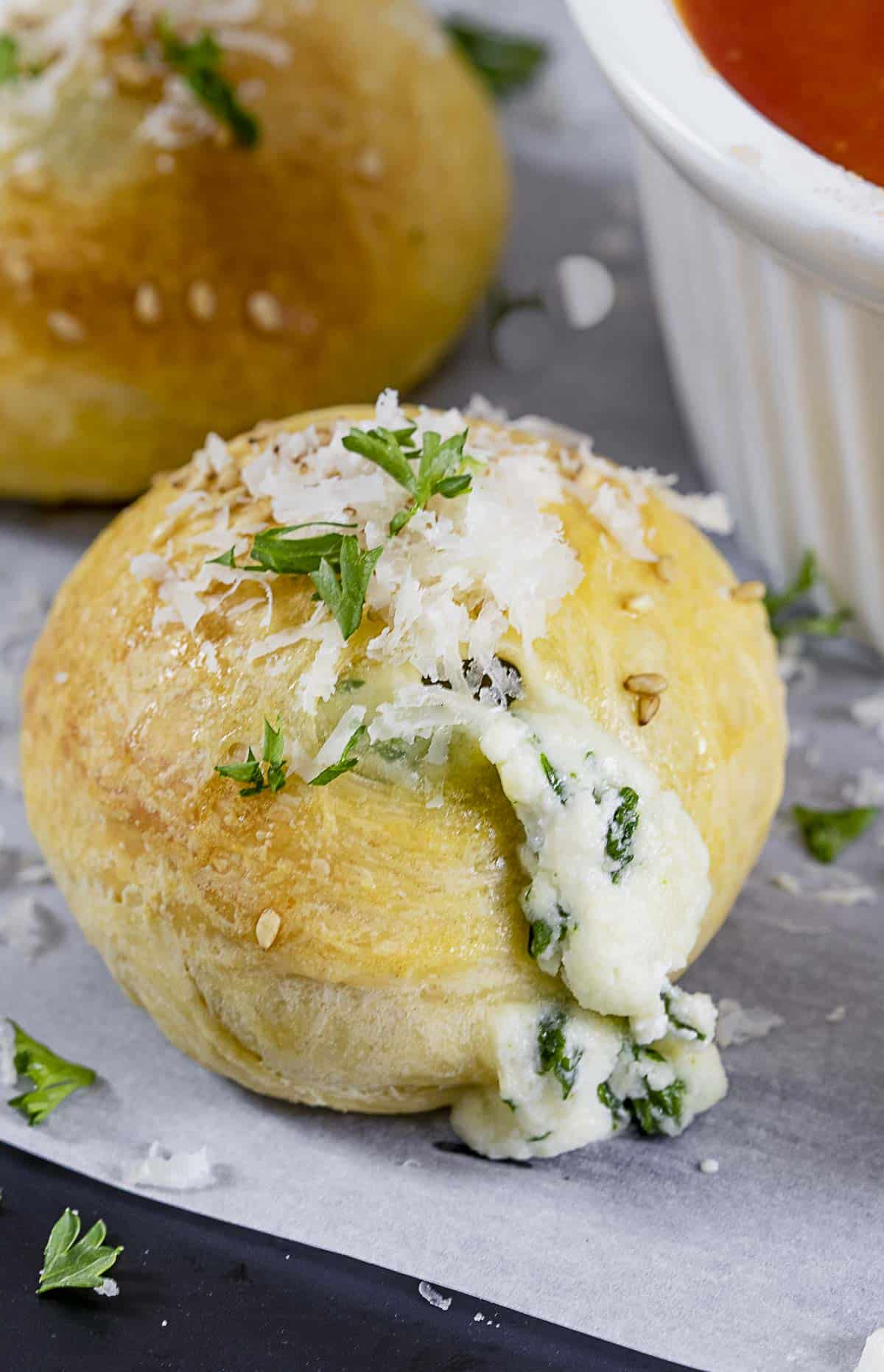 Close up of mini spinach calzone ball.