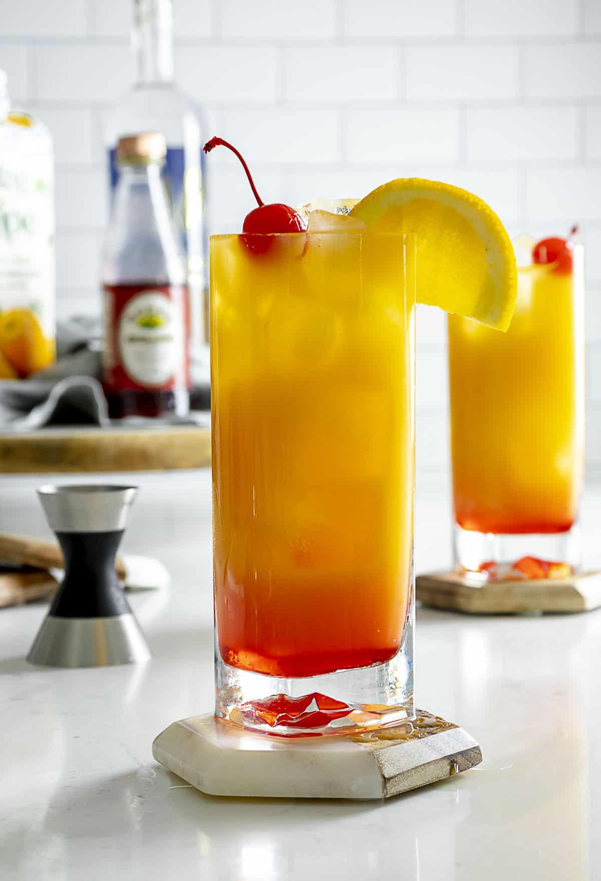 Side angle of vodka sunrise cocktail on table.