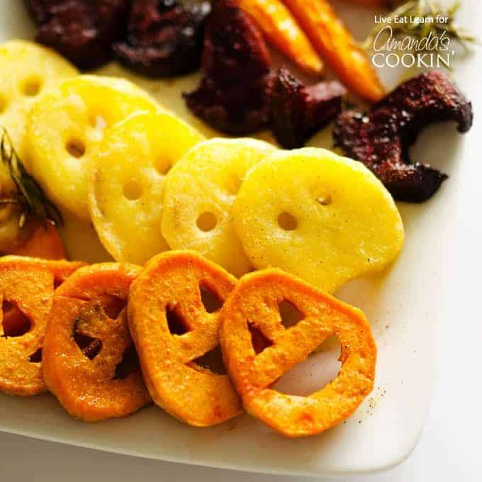 Roasted vegetables cut into spooky faces.